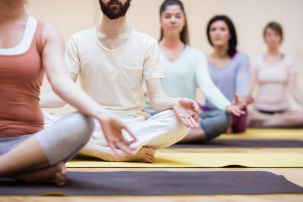 group-of-people-sitting-in-lotus-position_1170-225