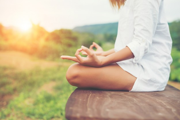 woman-hands-yoga-meditations-and-making-a-zen-symbol-with-her-ha_1150-794