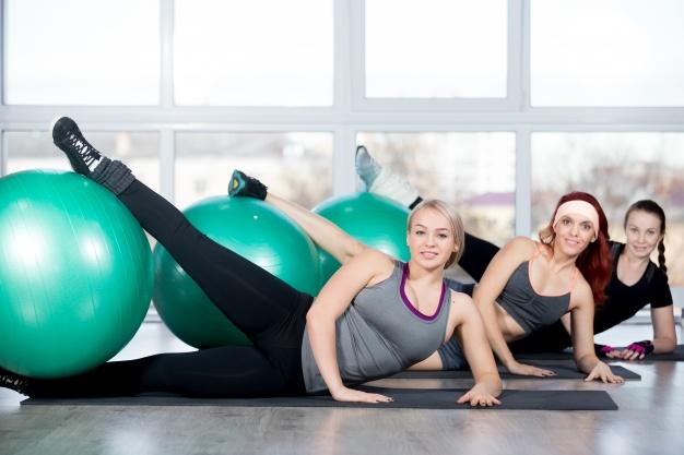 women-with-a-leg-over-a-ball_1163-979