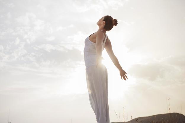 peaceful-woman-taking-a-deep-breath_23-2147662225