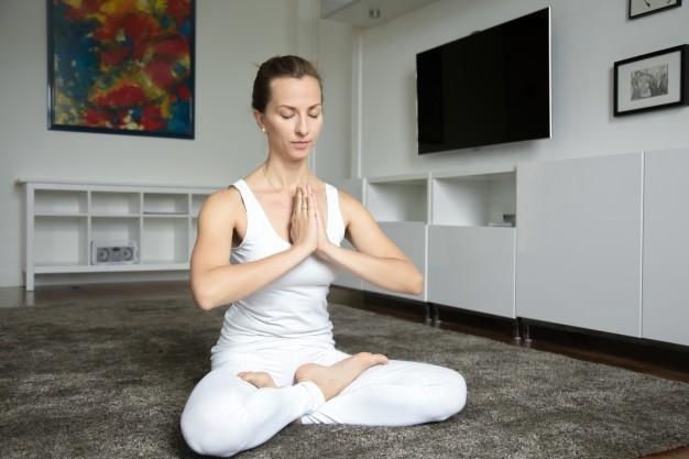 woman-sitting-in-lotus-exercise_1163-2150